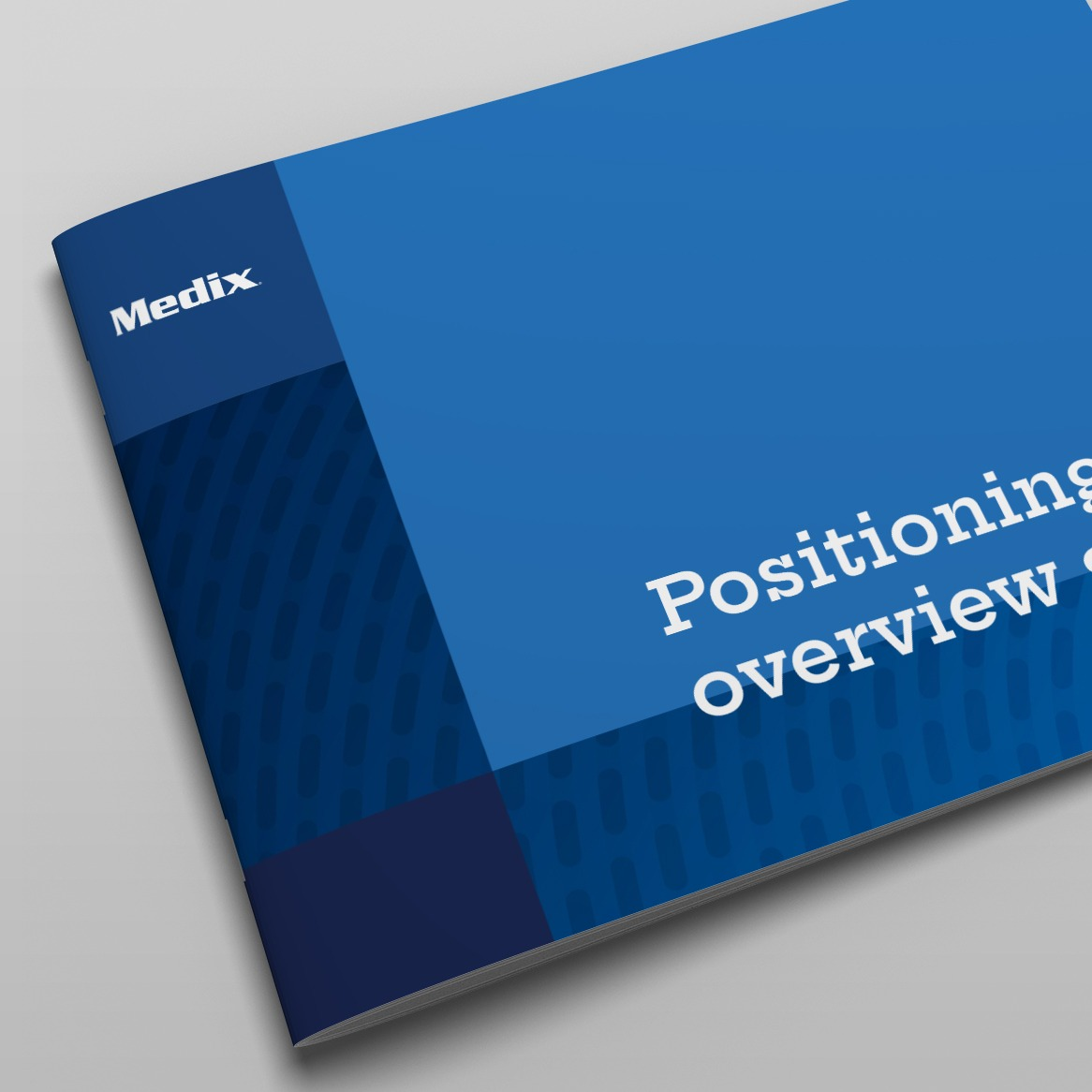A booklet laying flat on a table, featuring Medix logo and deep blue colors
