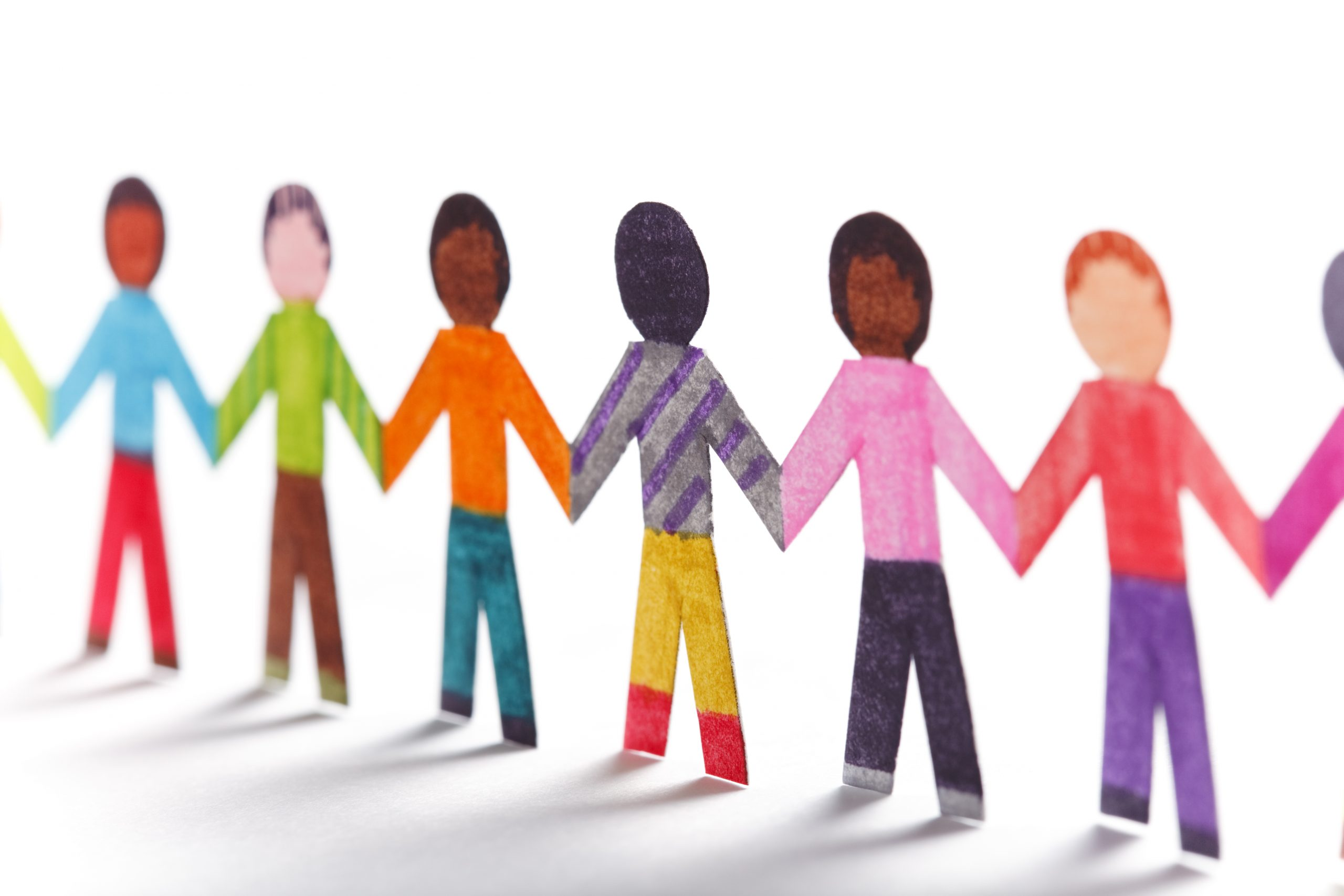 Colorful paper kids holding hands.